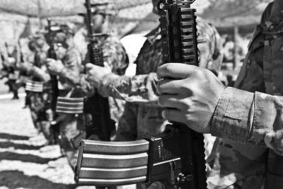 Hands of soldiers holding guns